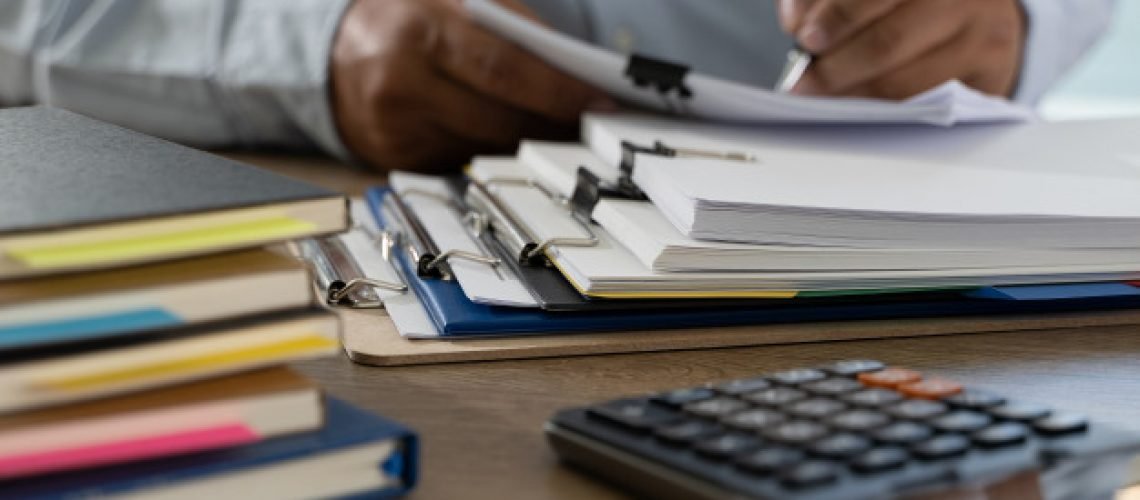 documents-paperwork-stack-of-business-paper-documents-on-office-on-desk-accounting-paper-file_36325-2337